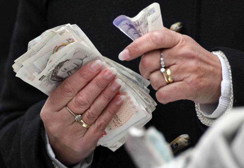 handling-money-141432034.jpg
