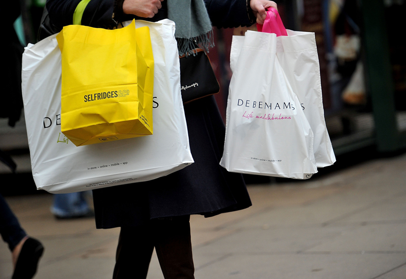 Christmas Shoppers Hunt For Gifts On The High Street