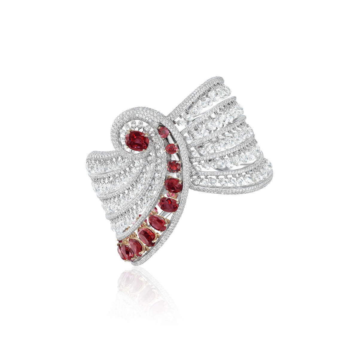 Floating like drapery on the skin, this unusually designed bracelet is adorned with natural Burma rubies and briolette diamonds.