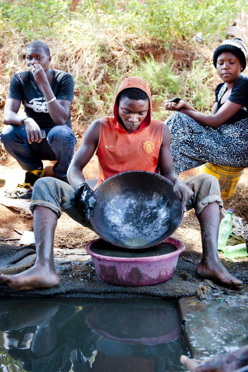 Processing gold, smallscale miner, Tanzania