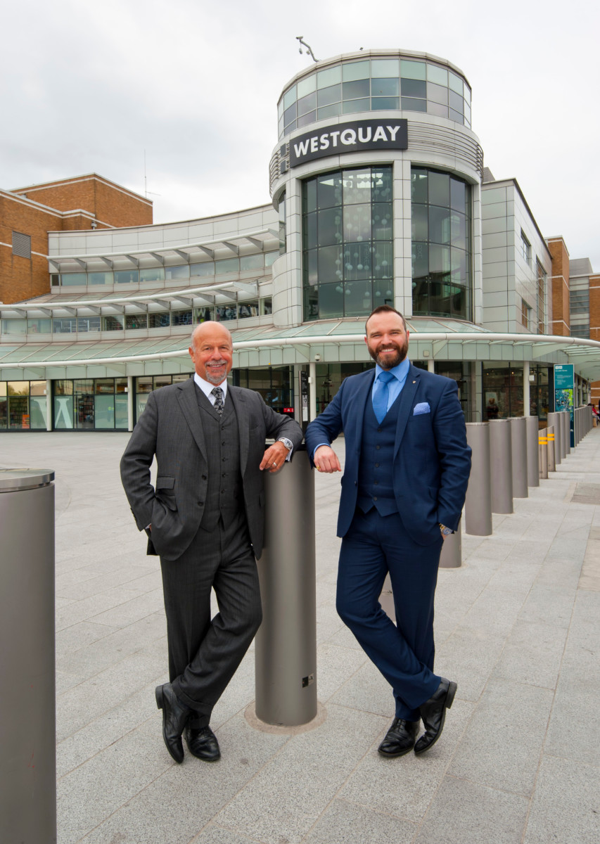 Parkhouse, the luxury family jewellers, has announced a store move from Above Bar, Southampton, to the new luxury corner in Westquay. The move coincides with a re-brand from Parkhouse to Laing and is a significant milestone for this leading sixth generation jewellery business. Pictured: Laing Chariman, Michael Laing OBE, (left) and his son Richard Laing, who is Director of the family business, in Southampton to officially make the announcement. They are standing infront of the WestQuay Shopping Centre. Picture: Chris Balcombe/FREE for use in all media