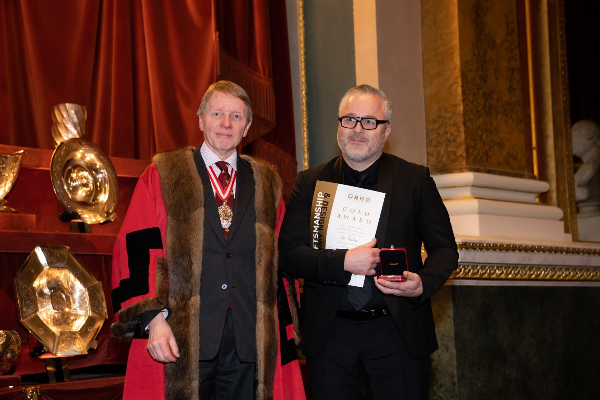 Tom Rucker receiving the Cartier Award from Prime Warden, Timothy Schreder